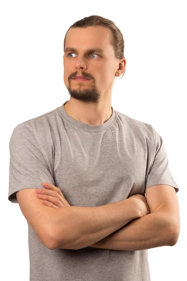 Individuo caucásico atractivo barbudo que parece lejos aislado en blanco imagen de archivo