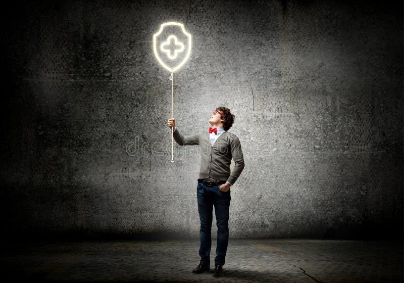 Individuo con el globo del concepto foto de archivo libre de regalías