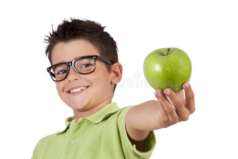 Individuo con la manzana verde imagen de archivo libre de regalías