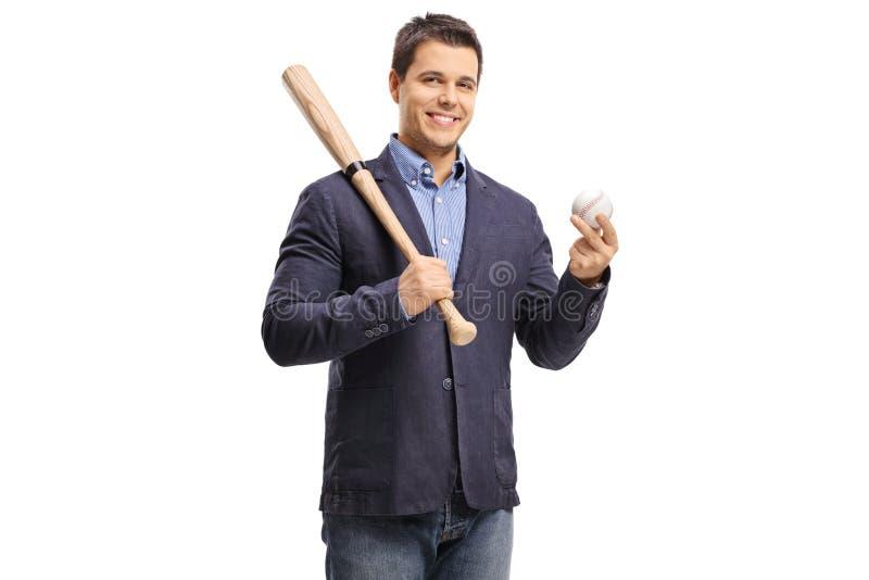 Individuo elegante que sostiene un bate de béisbol y una bola fotografía de archivo