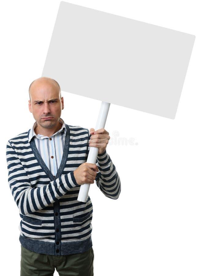 Individuo enojado con el cartel en blanco en un palillo imagenes de archivo
