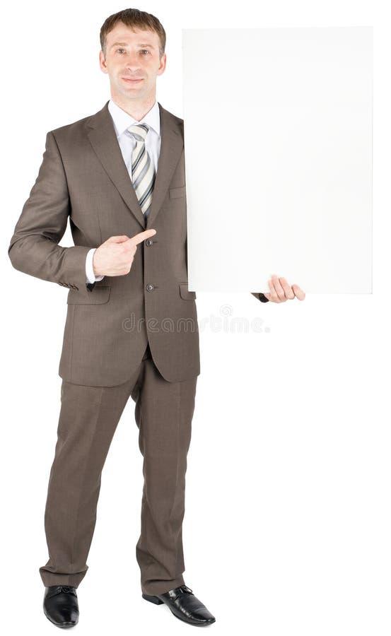 Individuo joven del negocio que lleva a cabo al tablero en blanco imagenes de archivo