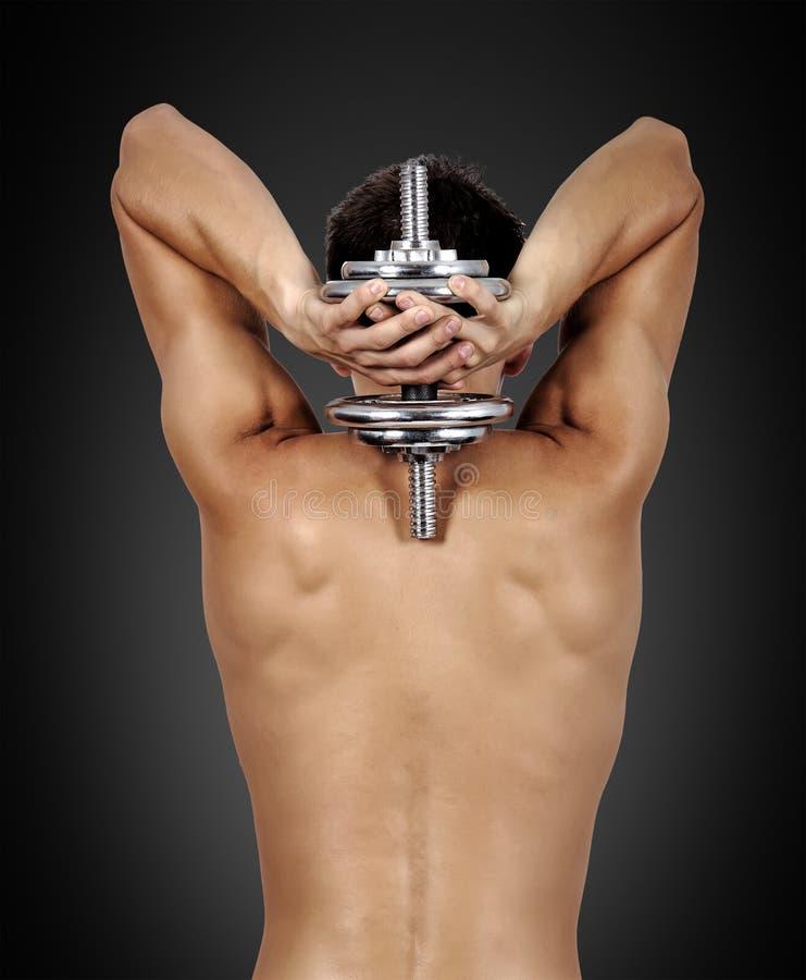 Individuo muscular con pesa de gimnasia fotos de archivo libres de regalías