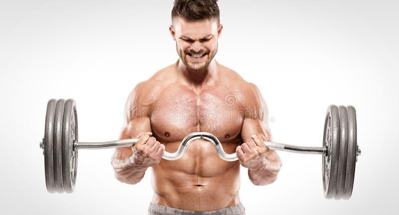 Individuo muscular del culturista que hace ejercicios con pesa de gimnasia grande fotos de archivo