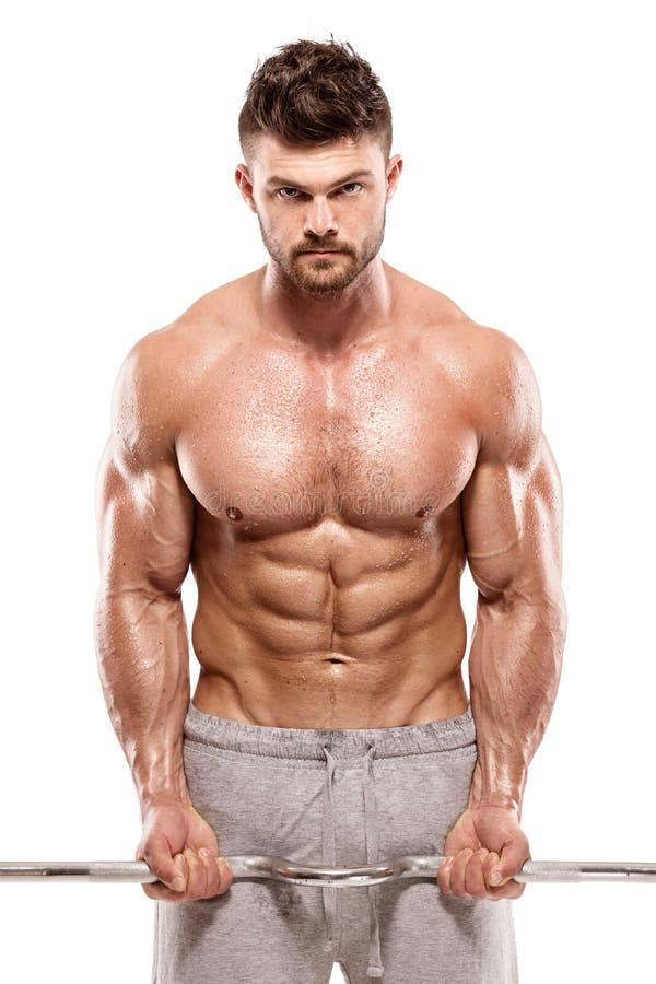 Individuo muscular del culturista que hace ejercicios con pesa de gimnasia grande imagen de archivo libre de regalías