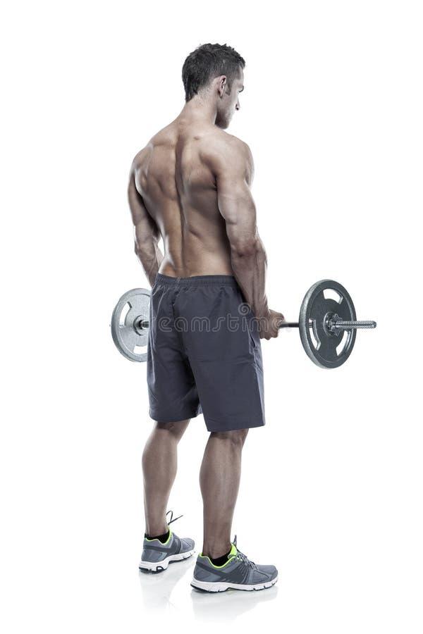 Individuo muscular del culturista que hace ejercicios con pesa de gimnasia grande encima imagenes de archivo