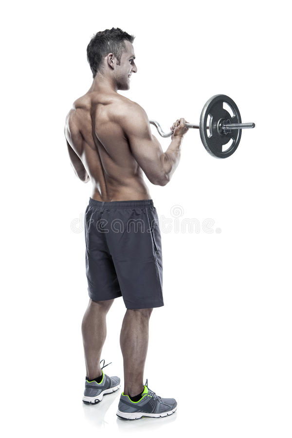 Individuo muscular del culturista que hace ejercicios con pesa de gimnasia grande encima foto de archivo libre de regalías