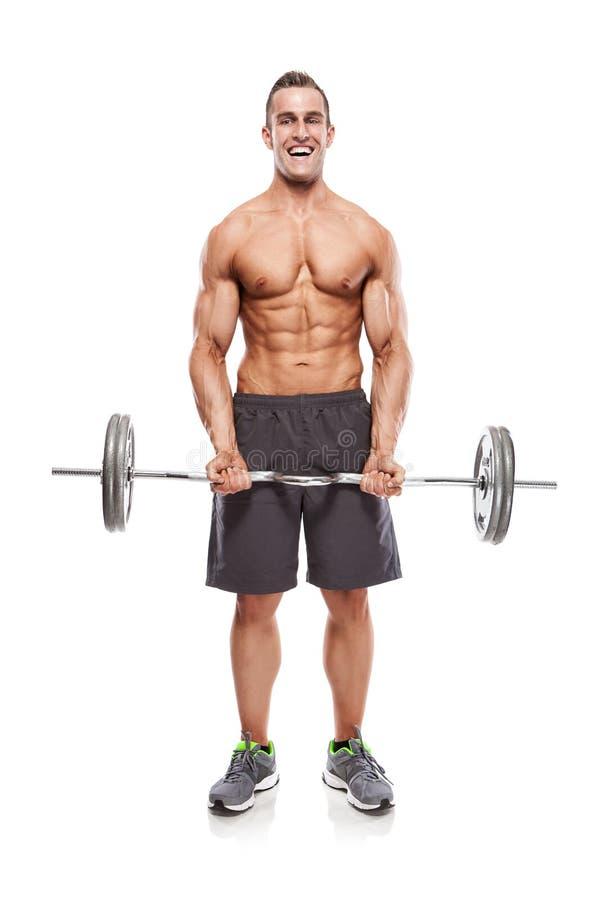 Individuo muscular del culturista que hace ejercicios con pesas de gimnasia sobre whi fotos de archivo