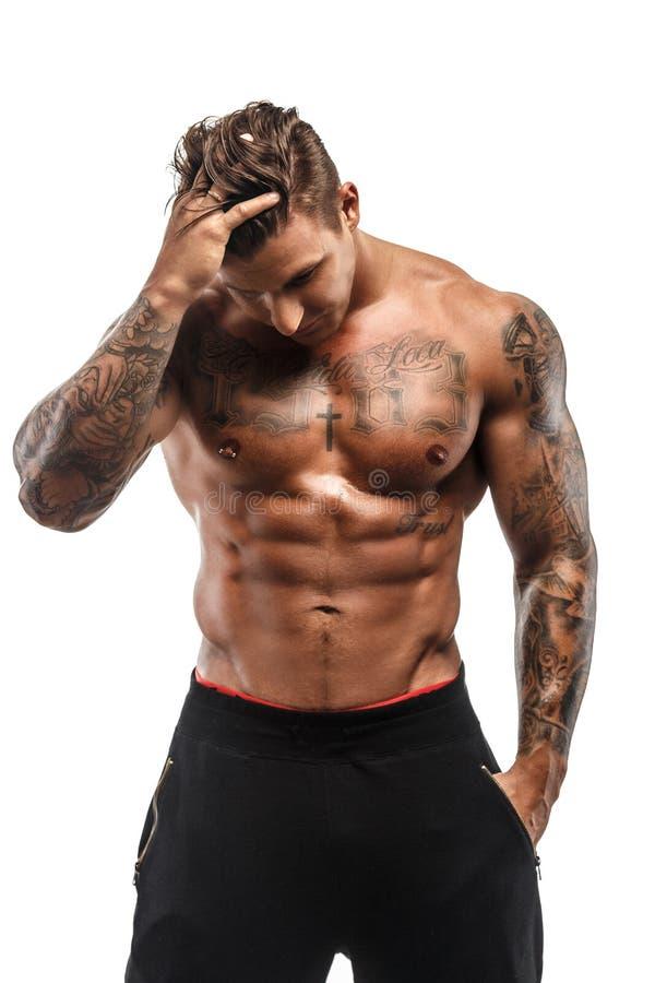 Individuo muscular tatuado imágenes de archivo libres de regalías