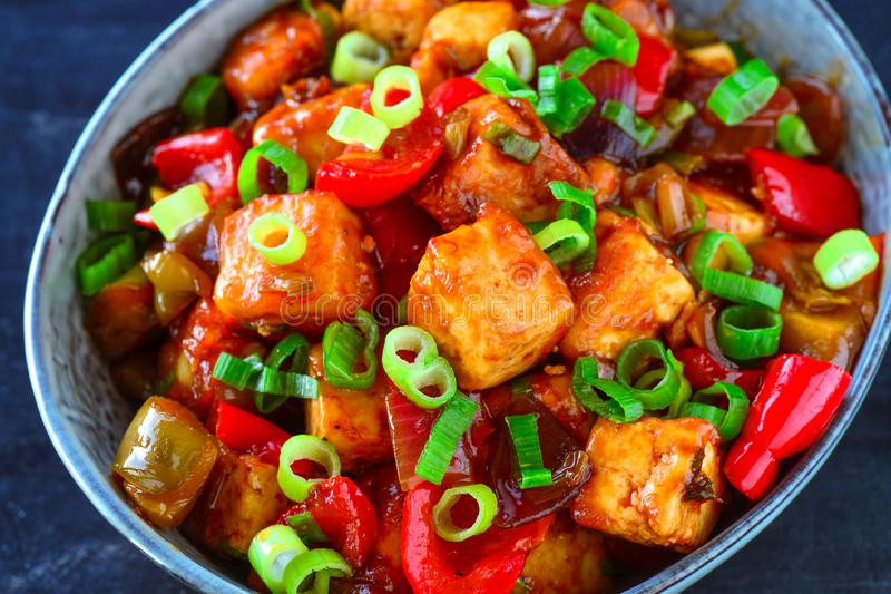 Indo chinese veg paneer manchurian. Street snack with paneer or cottage cheese cubes served with soya and sweet chilli sauce,shallots,green onions,red pepper stock photo