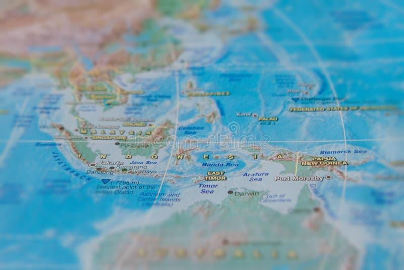 Indon?sia no fim acima no mapa Foco no nome do pa?s Efeito do Vignetting fotografia de stock