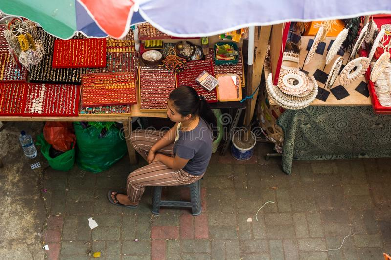 People Selling Goods At Market In Bali, Indonesia Editorial