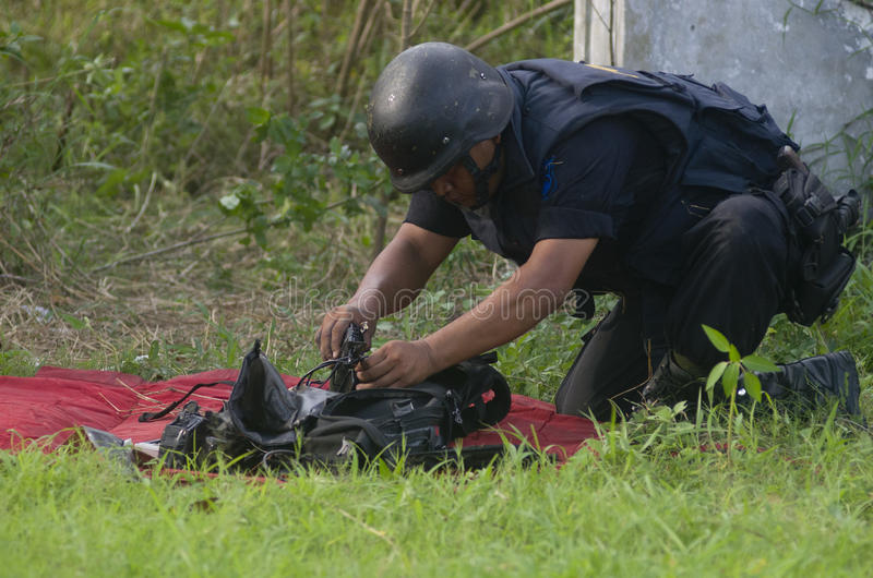 INDONESIA BOMB SQUAD. Member of Indonesian police bomb squad is trying to dispose an unknown package suspected as bomb or explosive materials in Sukoharjo royalty free stock photography