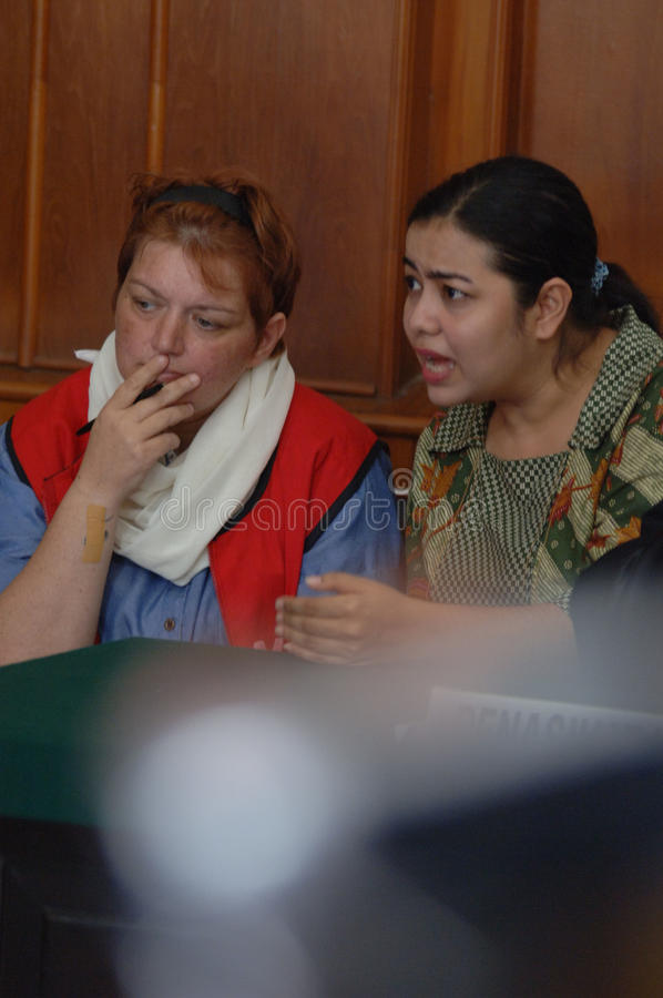 Indonesia Britain Drug Trial. British national Andrea Waldeck (L) is escorted by a court official prior to her trial in Surabaya on October 1, 2013. Waldeck is stock photo