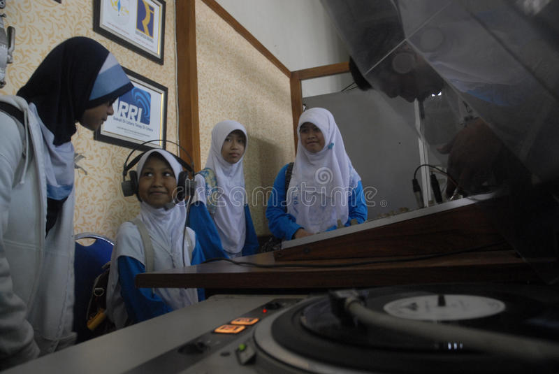 INDONESIA CALL TO STOP INAPPROPRIATE RADIO BROADCASTING. Students visit Indonesian Broadcasting Museum at Solo, Java, Indonesia. Indonesian Broadcasting stock images