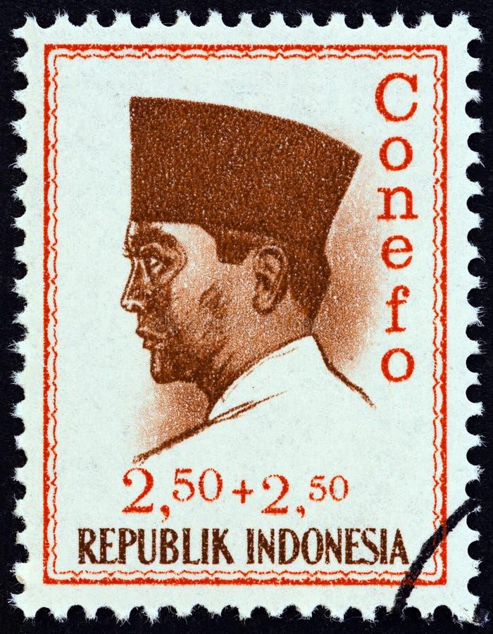 INDONESIA - CIRCA 1965: A stamp printed in Indonesia shows president Sukarno, circa 1965. stock photography