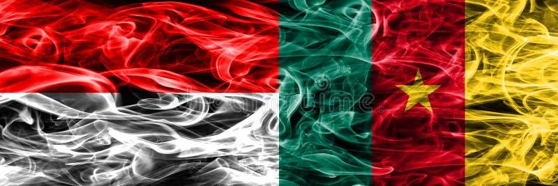 Indonesia contra las banderas del humo del Camerún colocadas de lado a lado Cuesta gruesa imagen de archivo