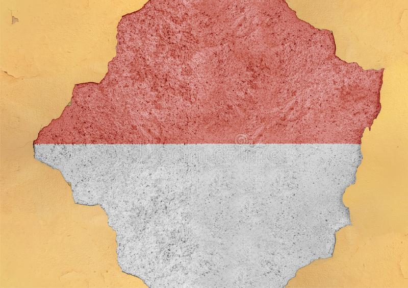 Indonesia cracked hole and broken flag in big concrete material facade. Structure royalty free stock image