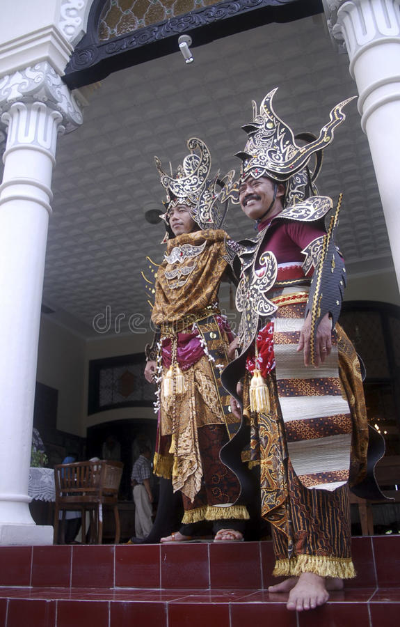INDONESIA CREATIVE JOBS. President Joko Widodo (left) and one of his officials wear Solo Batik Carnival costumes at Solo, Java, Indonesia. Indonesian business stock images