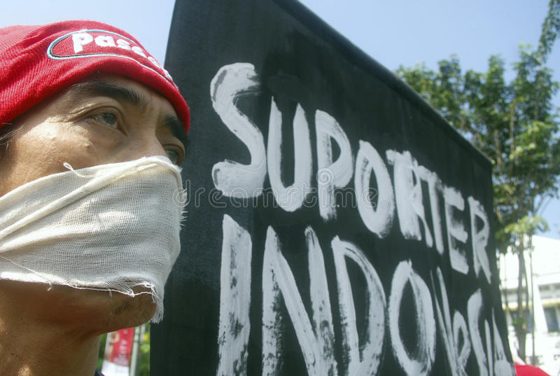 INDONESIA DEMOCRATIC HURDLE S. A protest held by civil group in Solo, Java, Indonesia. Indonesian democracy in the era of its new President Joko Widodo faces stock images