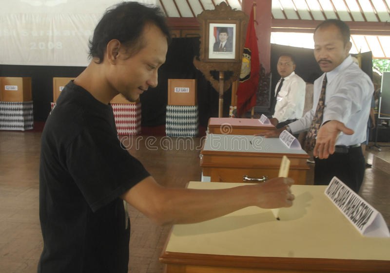 INDONESIA DEMOCRATIC HURDLE S. A voting process to elect a local leader in Solo, Java, Indonesia. Indonesian democracy in the era of its new President Joko stock images