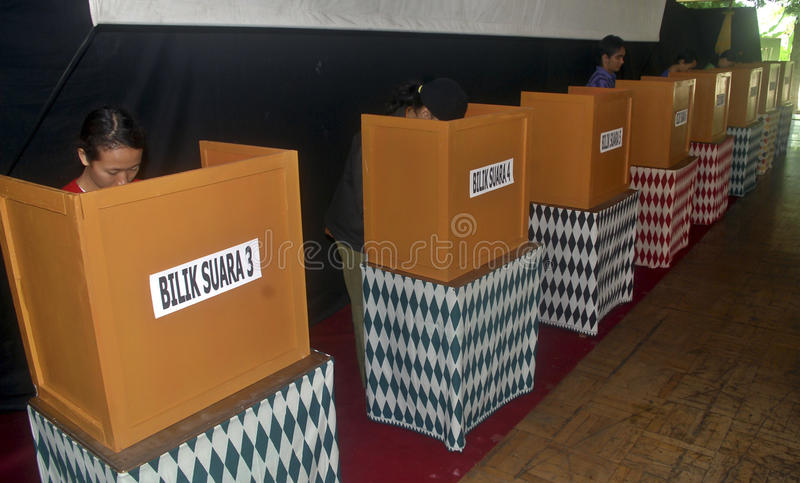 INDONESIA DEMOCRATIC HURDLES. A voting process to elect a local leader in Solo, Java, Indonesia. Indonesian democracy in the era of its new President Joko Widodo royalty free stock images