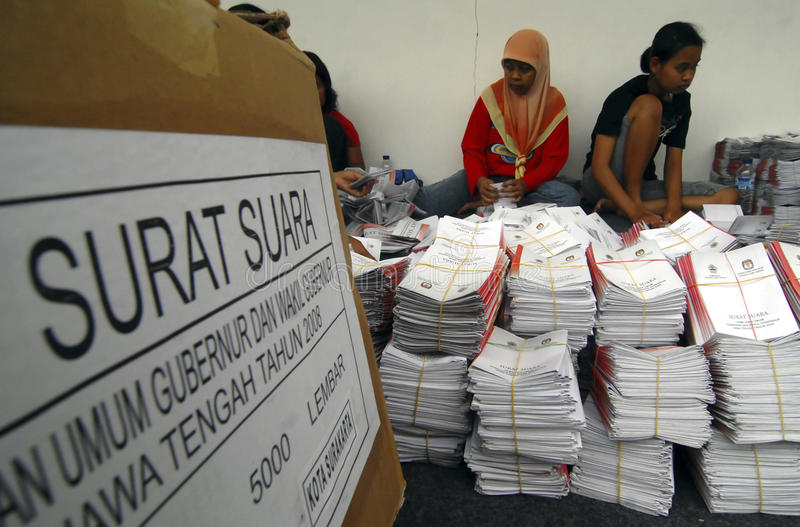INDONESIA DEMOCRATIC HURDLES. Workers are preparing ballots before a local election day in Solo, Java, Indonesia. Indonesian democracy in the era of its new royalty free stock images