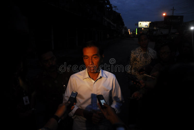 INDONESIA DISASTER LOSS. Indonesian President Joko Widodo speaks in front of a burned textile trade center in Solo, Java, Indonesia. For the last decade stock image