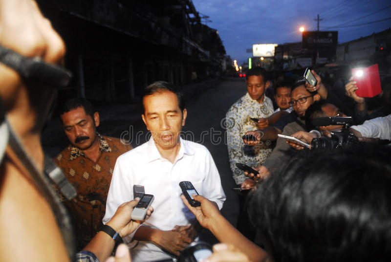 INDONESIA DISASTER LOSS. Indonesian President Joko Widodo speaks in front of a burned textile trade center in Solo, Java, Indonesia. For the last decade stock photos