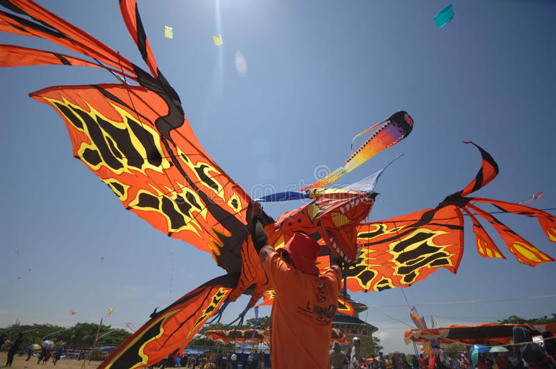 INDONESIA KITE FESTIVAL. In this photograph taken on September 22, 2013 an Indonesian kite enthusiast launches a giant insect-shaped kite in Surabaya city park stock photo