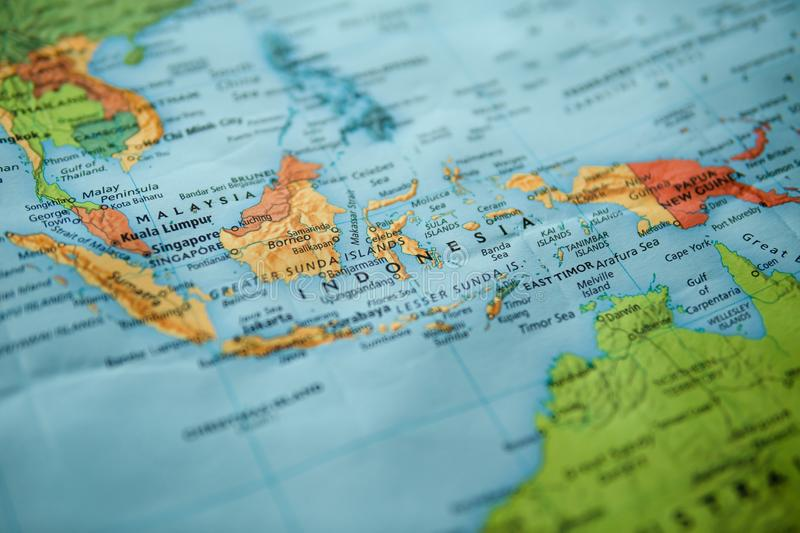 Indonesia on a map. Selective focus on label. Closeup shot royalty free stock image