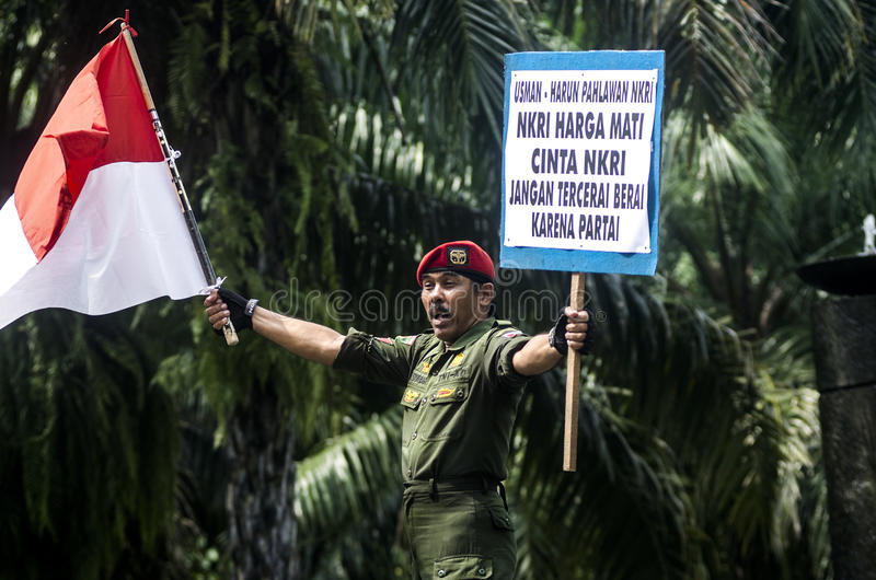 INDONESIA NATIONALISM SENTIMENT. Army Cpl. Partika Soebagyo wave Indonesian Flag at a self hosted loyalty action at Solo, Java, Indonesia. Indonesia use royalty free stock photography