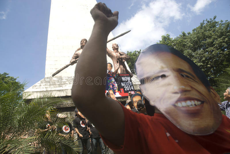INDONESIA POWER SUBSIDY CUT. Supporters wear the mask of Indonesian President Joko Widodo at Solo, Java, Indonesia. President Widodo, commonly known as Jokowi stock images