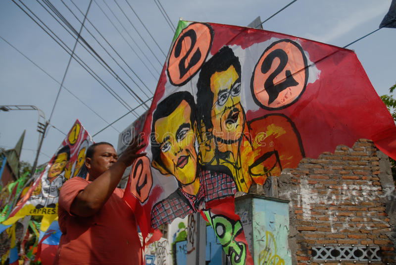 INDONESIA PRESIDENT KITE. A vendor sells kites which have the face of newly elected President Joko Widodo painted on, on Slamet Riyadi Street, Solo, Java stock photography