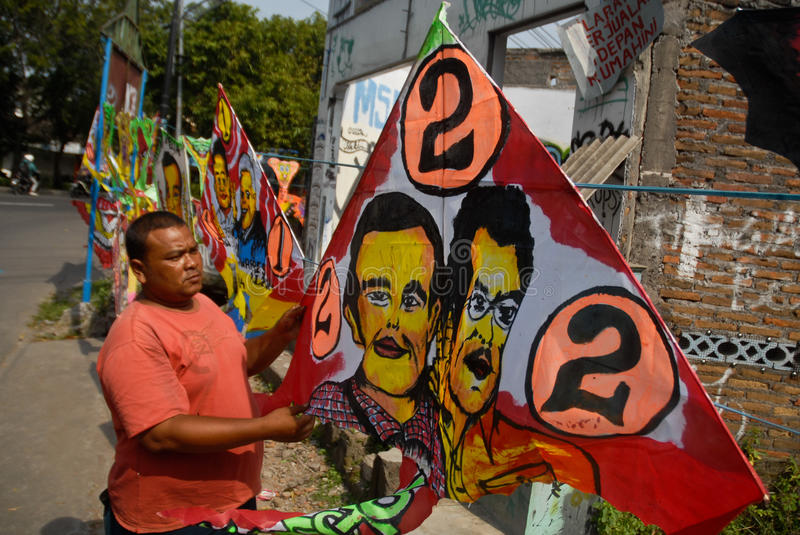 INDONESIA PRESIDENT KITE. A vendor sells kites which have the face of newly elected President Joko Widodo painted on, on Slamet Riyadi Street, Solo, Java stock images