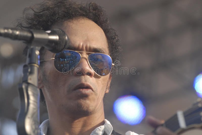 INDONESIA'S LEGENDARY ROCK GROUP. Indonesian legendary rock band Slank while performing at Boyolali, Java, Indonesia. The group which is considered a cult by its stock photos