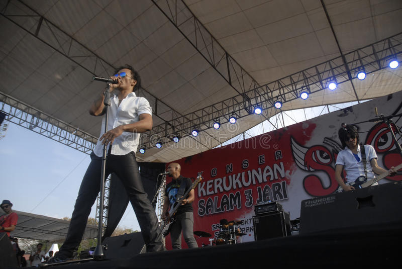 INDONESIA'S LEGENDARY ROCK GROUP. Indonesian legendary rock band Slank while performing at Boyolali, Java, Indonesia. The group which is considered a cult by its royalty free stock images