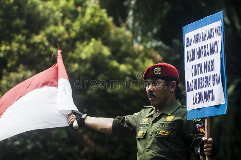 INDONESIA'S STRONGEST ARMY MAN. Cpl. Partika Subagyo of Indonesian Army, which is dubbed as Indonesia's Toughest Soldier. Subagyo is the official national record royalty free stock photo