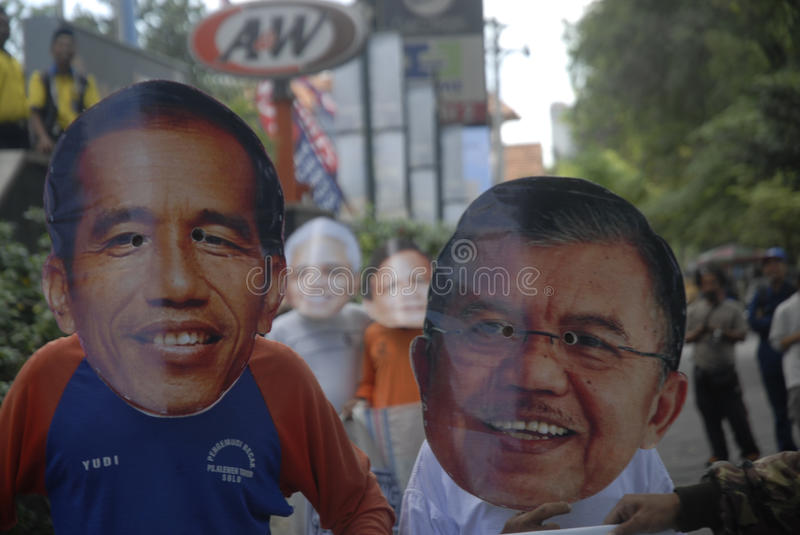 INDONESIA TIGHTEST PRESIDENTIAL ELECTION. Supporters use mask of Presidential candidate on a sack running race game, to call for fair play on the election, in royalty free stock images