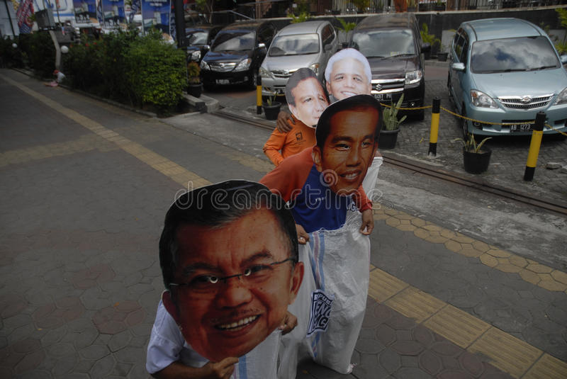 INDONESIA TIGHTEST PRESIDENTIAL ELECTION. Supporters use mask of Presidential candidate on a sack running race game, to call for fair play on the election, in stock photography