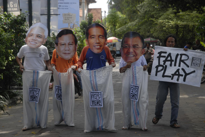 INDONESIA TIGHTEST PRESIDENTIAL ELECTION. Supporters use mask of Presidential candidate on a sack running race game, to call for fair play on the election, in stock image