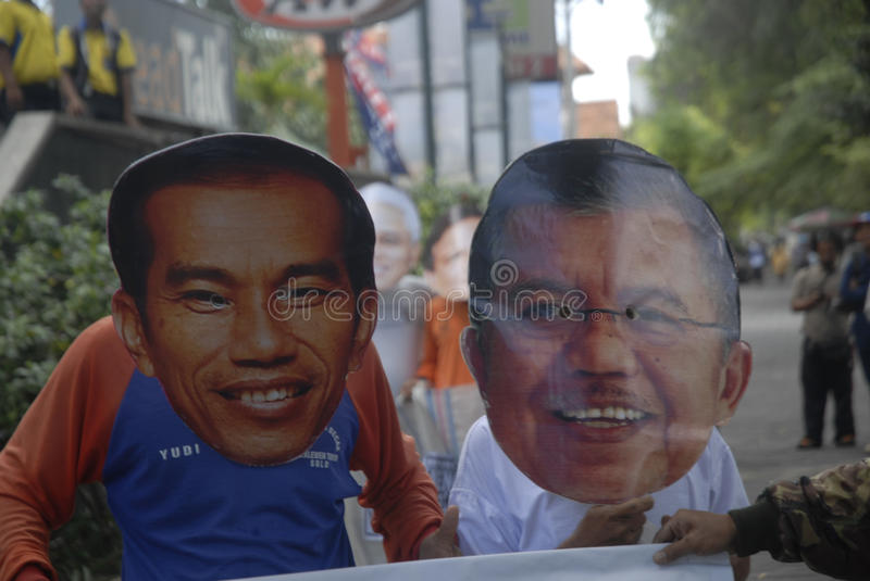 INDONESIA TIGHTEST PRESIDENTIAL ELECTION. Supporters use mask of Presidential candidate on a sack running race game, to call for fair play on the election, in royalty free stock photo