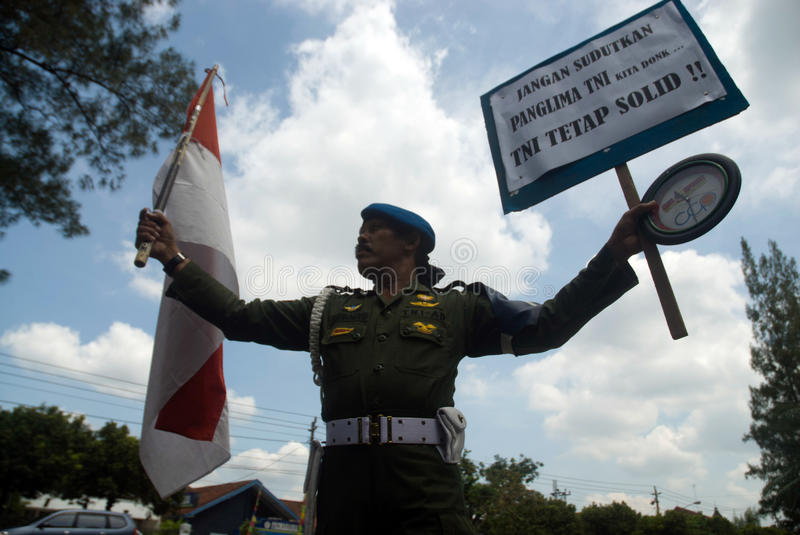 INDONESIA TNI PROFESSIONALISM. Cpl. Partika Subagyo of Indonesian Army hold a one person rally to support military professionalism of Indonesian Armed Forces ( stock photos
