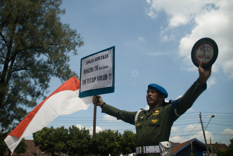 INDONESIA TNI PROFESSIONALISM. Cpl. Partika Subagyo of Indonesian Army hold a one person rally to support military professionalism of Indonesian Armed Forces ( stock photo
