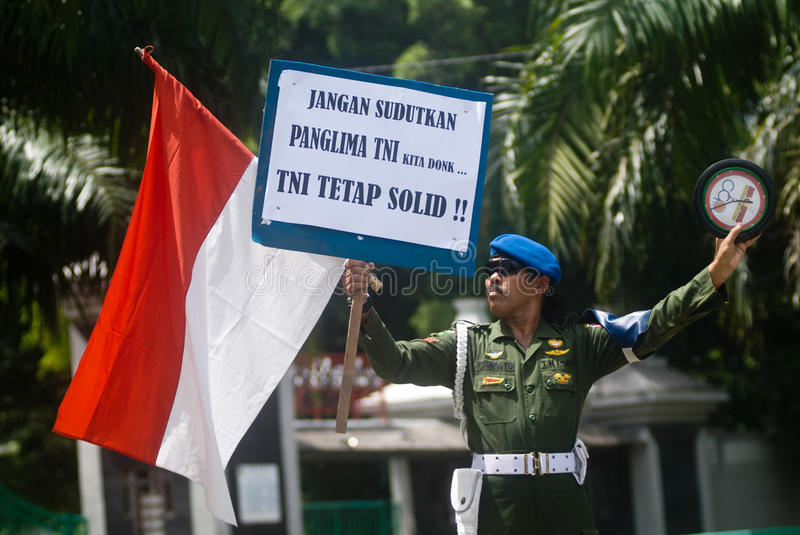 INDONESIA TNI PROFESSIONALISM. Cpl. Partika Subagyo of Indonesian Army hold a one person rally to support military professionalism of Indonesian Armed Forces ( stock image