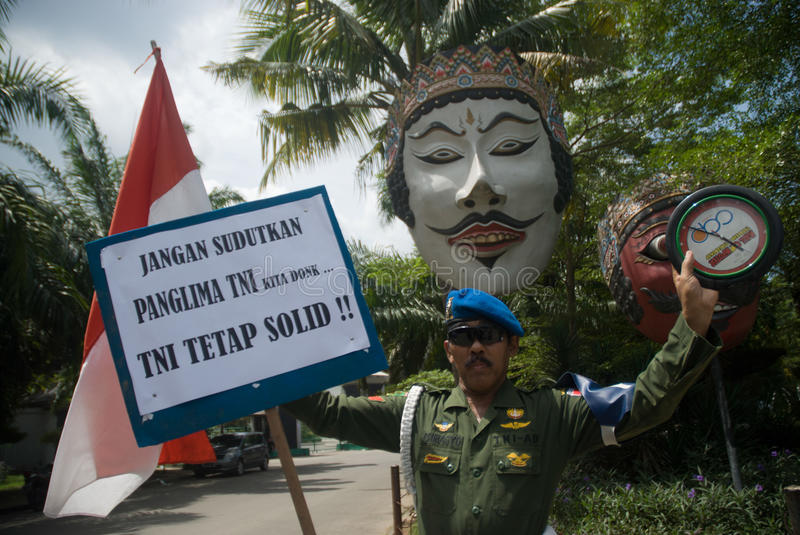 INDONESIA TNI PROFESSIONALISM. Cpl. Partika Subagyo of Indonesian Army hold a one person rally to support military professionalism of Indonesian Armed Forces ( stock images