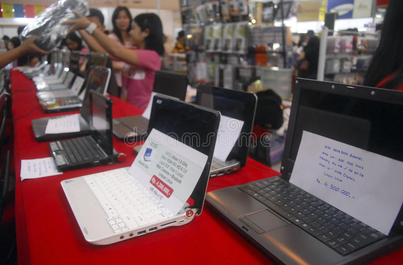 INDONESIA TO RAISE TECH FUND. New notebook computers displayed at computer store in Solo, Java, Indonesia. Rudiantara, Indonesia's new minister of communications royalty free stock photo