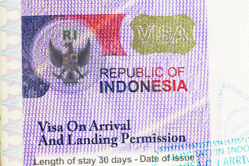 Indonesia Visa. Detail of 2014 Indonesia Visa on passport stock photos
