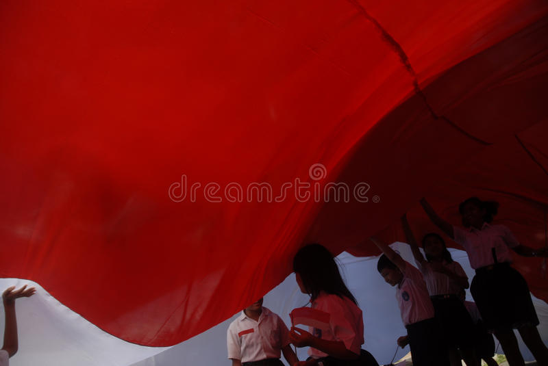 INDONESIA WORLD BANK OFFER. Students hold Indonesian National Flag The Red and White at Solo, Java, Indonesia. The World Bank offered up to $11 billion in new royalty free stock photos