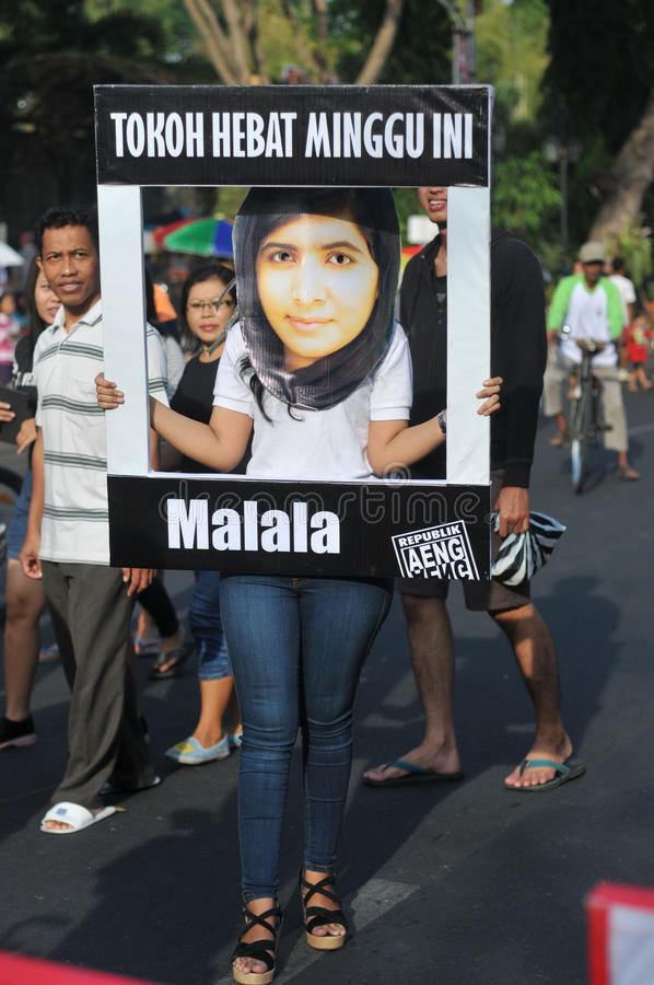 An Indonesian activists celebrate Malala Yousafzai Nobel Peace Prize award. SURAKARTA, INDONESIA - October 12 : An Indonesian activist wearing a mask of the 17 royalty free stock images